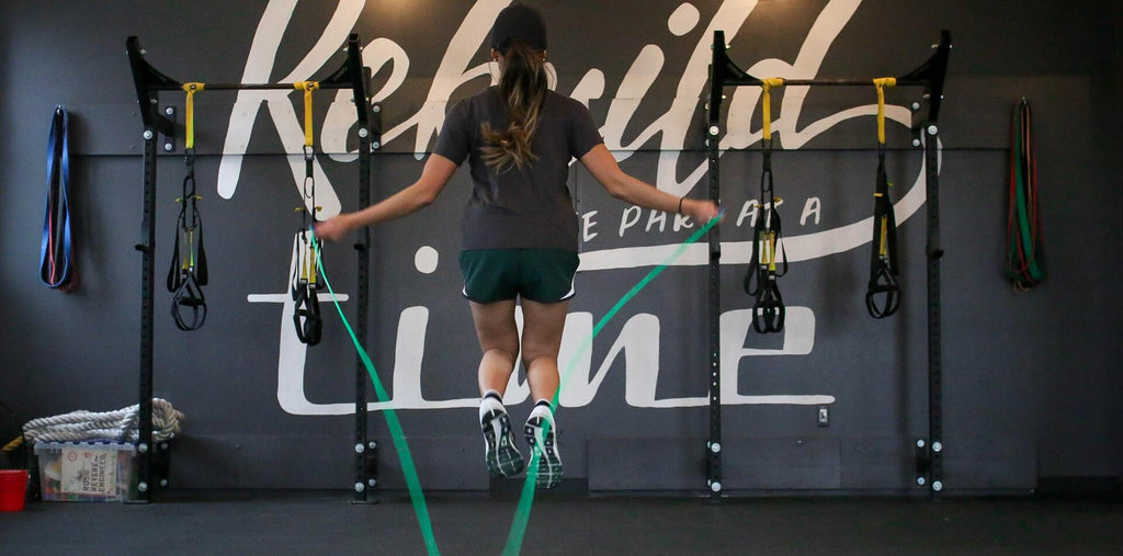 A woman skipping rope in the gym