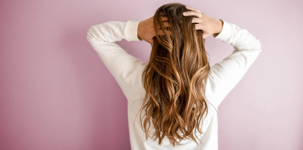 A woman with beautiful hair after taking collagen
