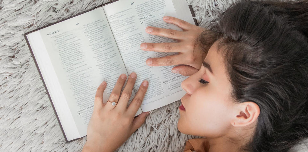 A woman sleeping after studying
