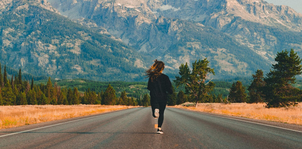 A women running on the road to boost her energy