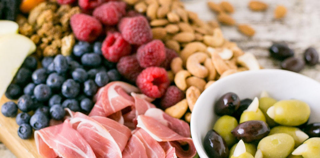 Berries, nuts, and prosciutto as perfect morning snacks