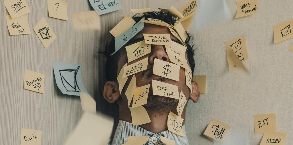 A man stressed with numerous tasks