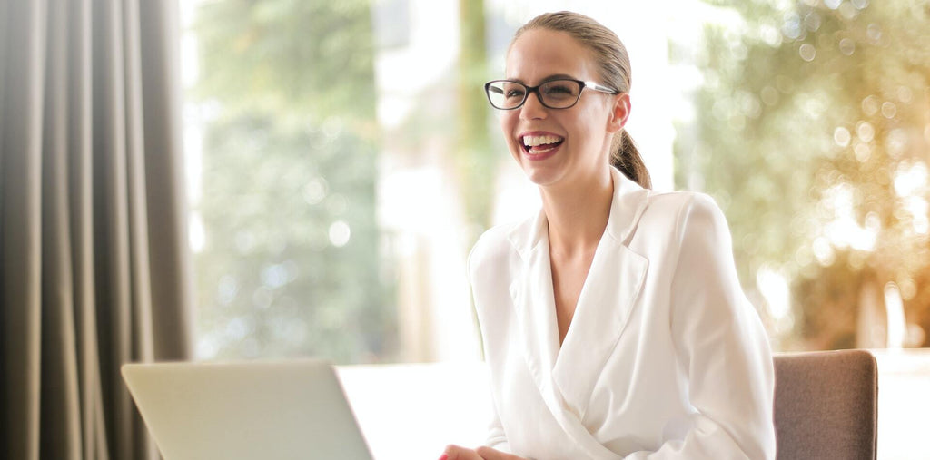 An energized woman at work after taking supplements