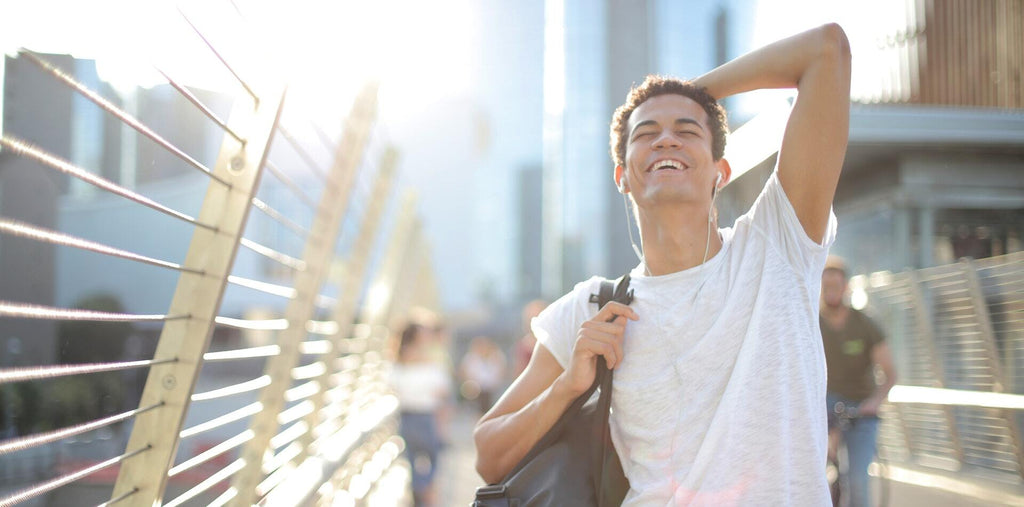 Happy man walking on the street after taking Omega-3 supplements