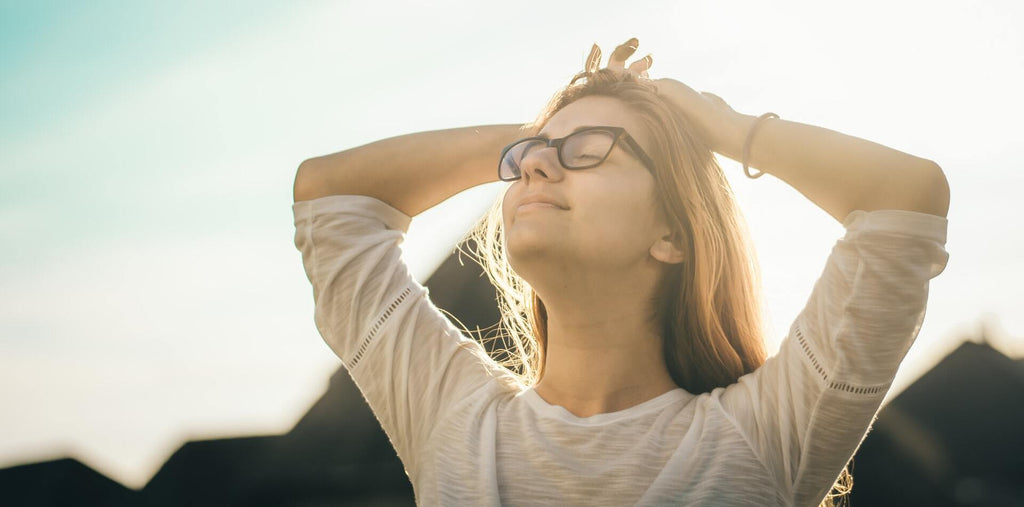 A happy and calm woman in a sunlight