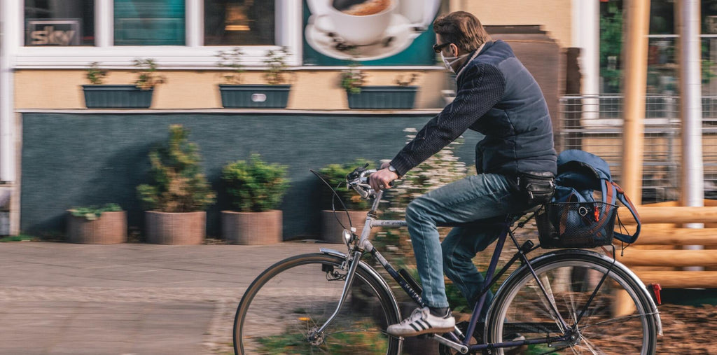 A man riding a bicycle to boost his stamina and energy