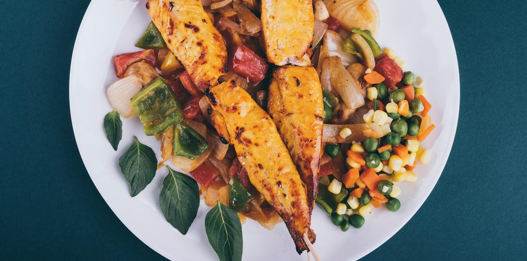 A meal with chicken and veggies to restock your body's protein stores