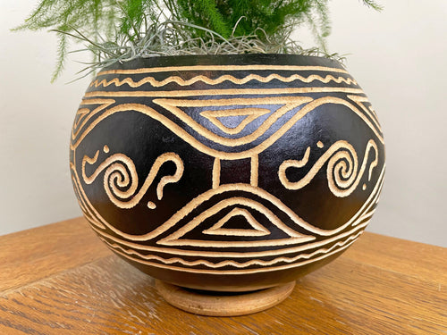 Close up of hand carved black and white kenyan pot