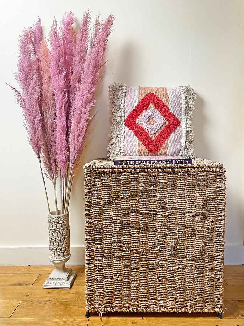 Lilac and pink pampas grass in vase by Calabasas