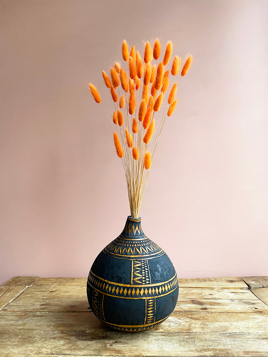 Natural geometic calabash vase with orange bunny tails by Calabasas