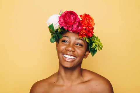 woman smiling with flowers on her head