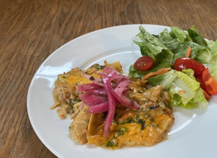 "East meets West ""Slathered"" King Ranch Chicken Casserole Garnished with Pickled Red Onions"