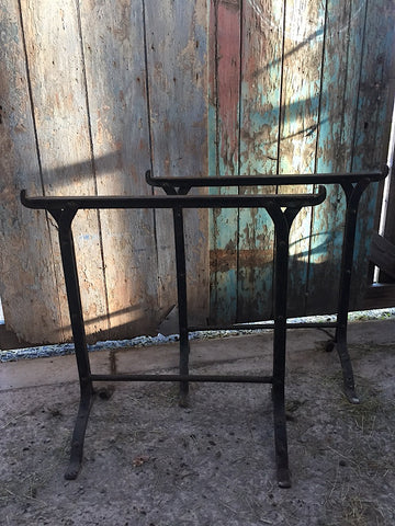 Vintage industrial pair of cast iron trestles table legs