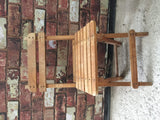 Children's slatted wooden chair
