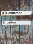 Salvaged railway toilet signs
