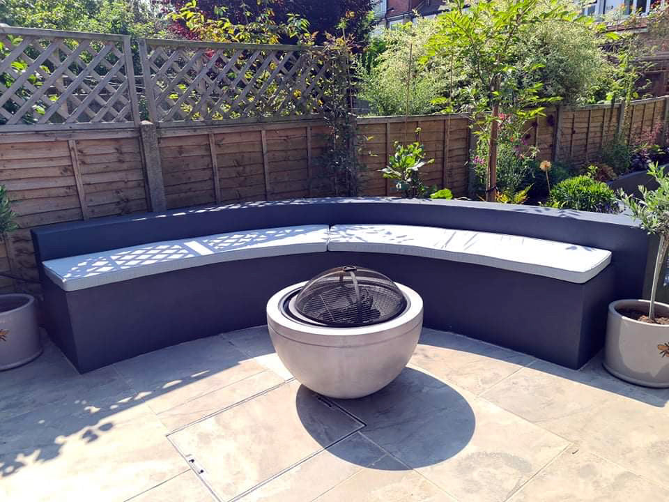 Garden Foam Bench Cushion in Grey Tones on a Cement Curved Seating Area