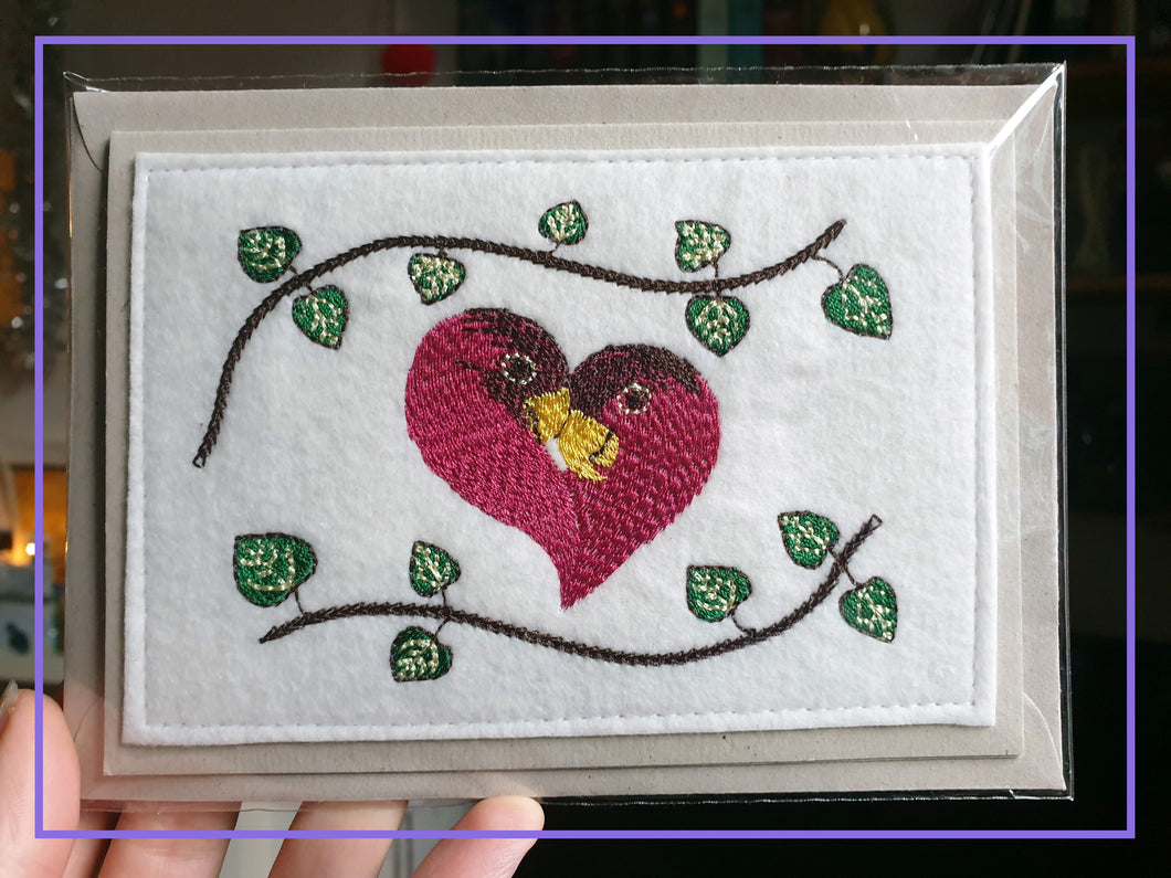 Love Birds and String of Hearts Plant Design Embroidered onto White Felt Fabric
