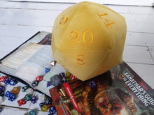 Load image into Gallery viewer, Giant Plush Velvet D20 Dice. Deluxe giant dice in a daffodil yellow velvet fabric and embroidered with rich yellow coloured numbers.