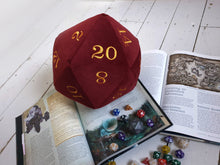 Load image into Gallery viewer, Huge Velvet D20 Plush Dice. Deluxe giant dice in a deep red velvet fabric and machine embroidered with rich yellow coloured numbers.