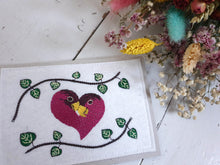 Load image into Gallery viewer, Love Birds and String of Hearts Plant Design Embroidered onto White Felt Fabric