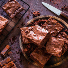 Load image into Gallery viewer, chocolate brownies on a plate with knife