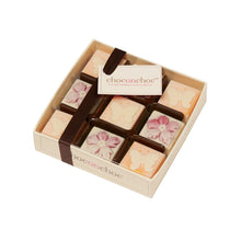 Load image into Gallery viewer, pink and yellow white chocolate butterfly and flower chocolates in a box