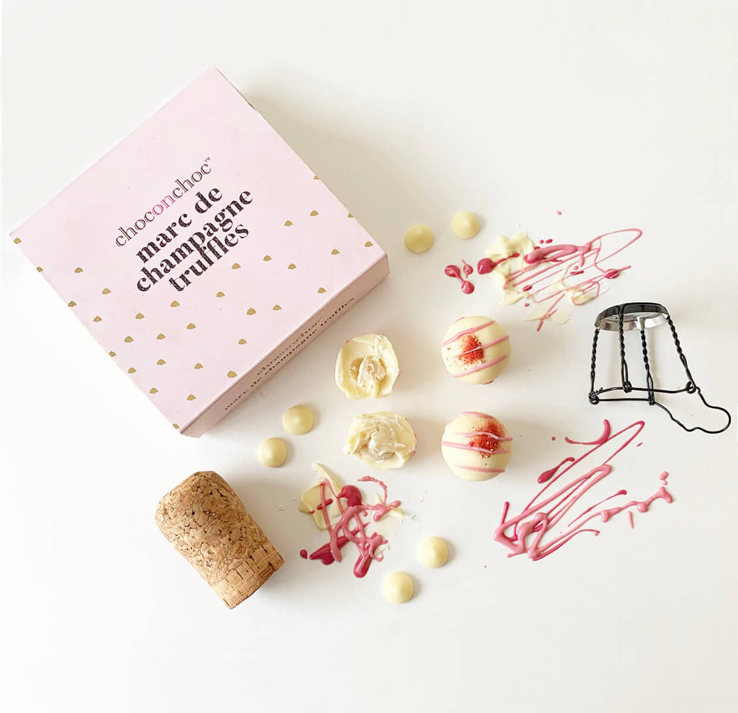marc de champagne chocolate truffles, pink box and champagne cork