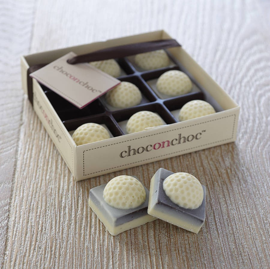 nine square white chocolate golf balls in a box