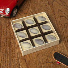 Load image into Gallery viewer, nine white and dark chocolate rugby balls in a box