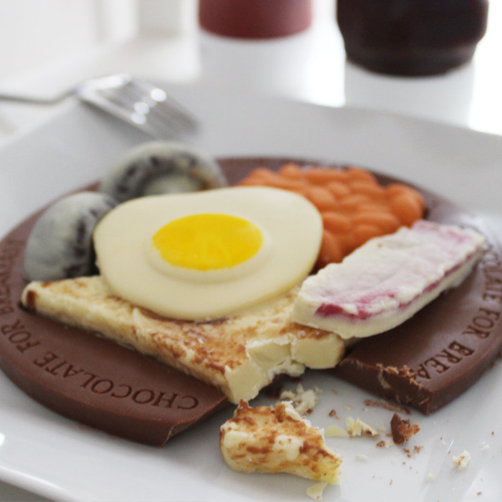 chocolate breakfast with chocolate bean, egg, bacon, toast and mushrooms