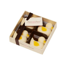 Load image into Gallery viewer, four yellow, white Belgian chocolate ducks in a box