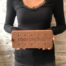 Load image into Gallery viewer, giant milk chocolate bourbon shaped biscuit held by a woman