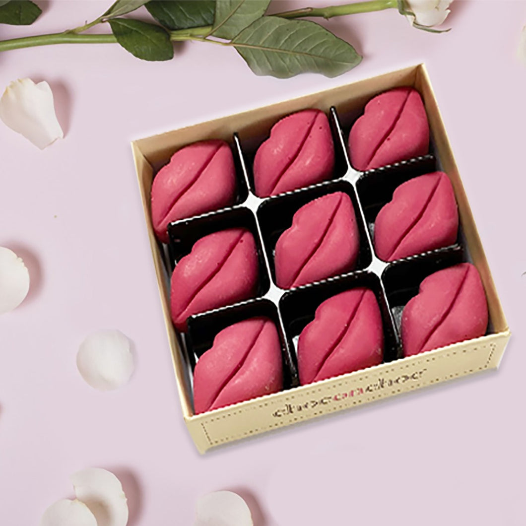 Nine lip-shaped chocolates in a box
