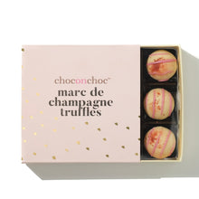 Load image into Gallery viewer, open pink box of marc de champagne truffles