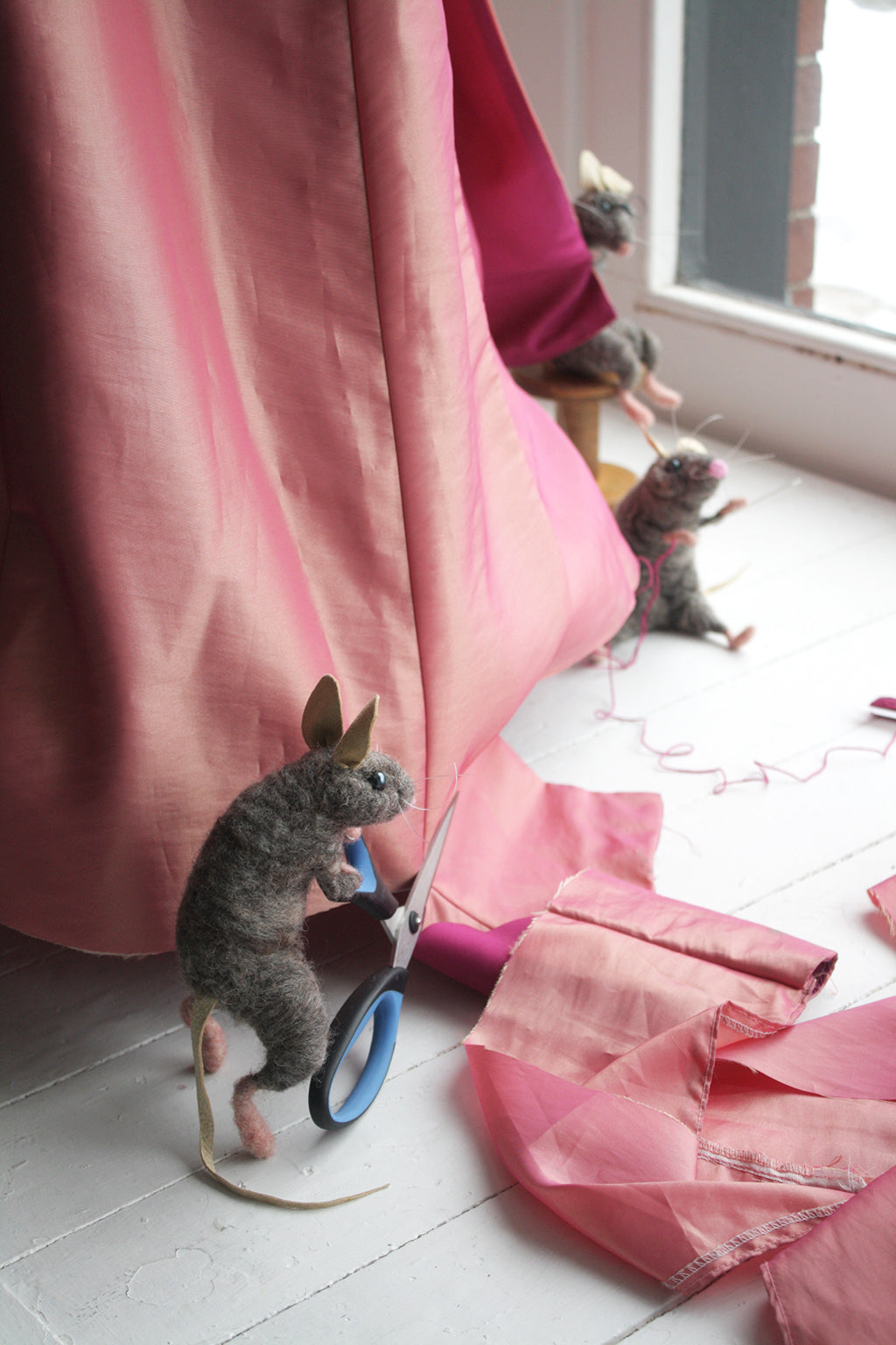 The Lunenburg Makery - Needle felted mouse in Cinderella display window.