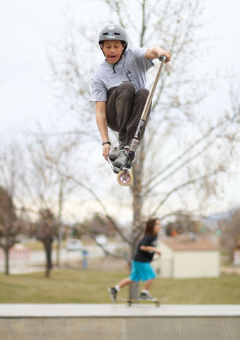 Kade Schable riding his scooter