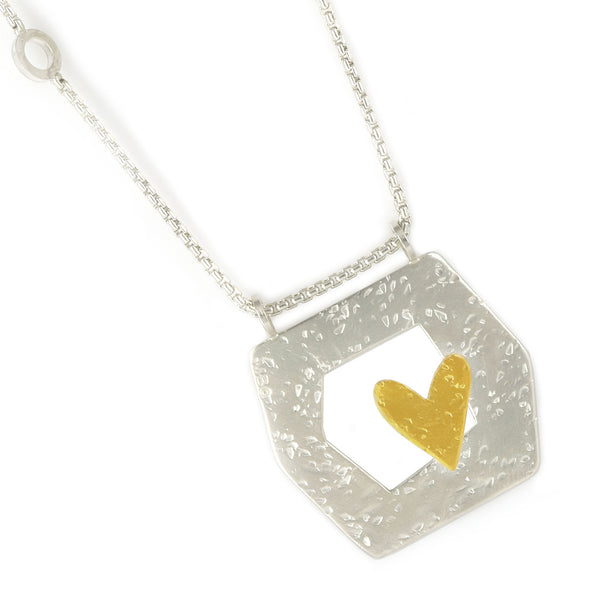 framed heart silver and gold necklace close up by maria blondet