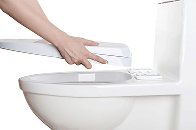 Alpha one v2 being installed on a toilet