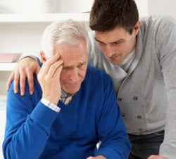 young man consoling elderly man