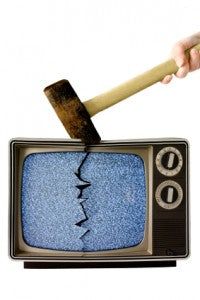 sledgehammer crushing television with a huge crack dividing it
