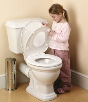 Child lifting toilet's seat and lid