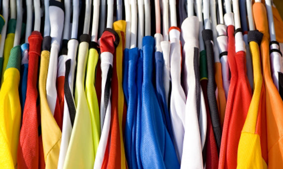 a collection of clothing ranging in color
