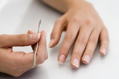 hands with manicure tool