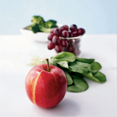 vegetables and fruit with apple in focus