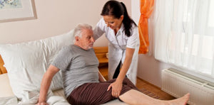 Assisting elderly person to their bed