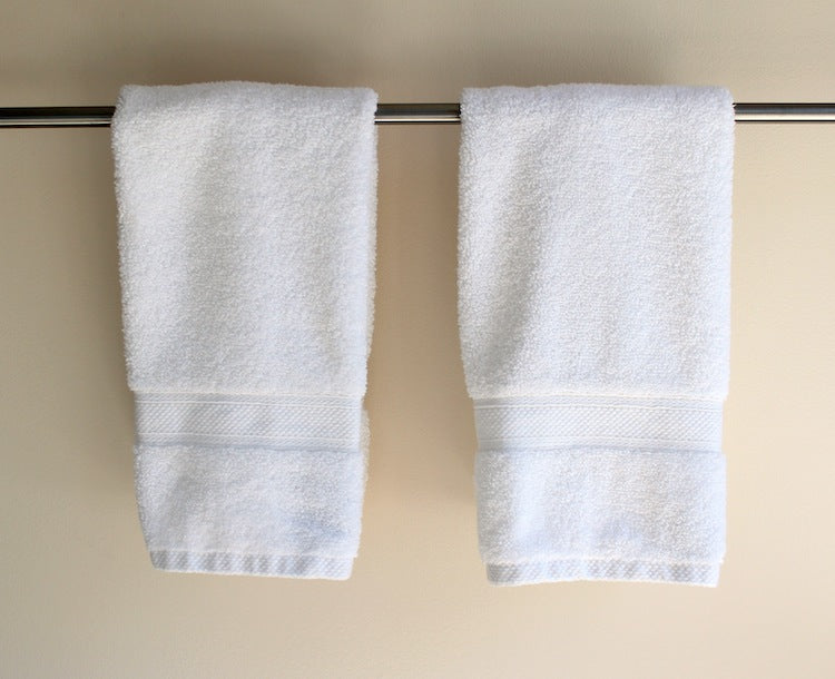 two hand towel hanging side by side