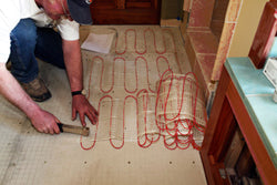 a professional installing a heated floor