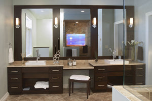 medicine cabinet with television built into the mirror
