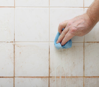 dirty tile wiped clean with sponge