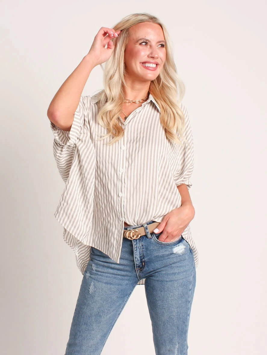 woman in jeans and a striped blouse